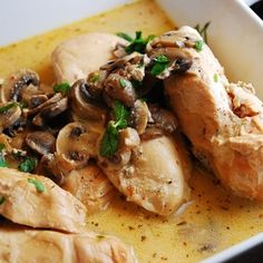 Crockpot Italian Chicken: Creamy and flavorful, this is one slow cooker recipe that's a real crowd pleaser. A wine and cream cheese based sauce is seasoned with Italian dressing and smothers mushrooms and chicken breasts. It's an easy Weight Watchers crock pot recipe