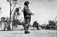 A British paratrooper in a village to the east of the River Orne.