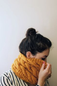 This lovely mustard yellow scarf has a cabled pattern and can be worn multiple ways. -Hand-knit with chunky yarn -75% acrylic, 25% wool -stretchy and