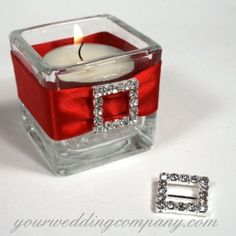 """Imagine this with royal ribbon and oval charms, and battery-operated candles.  Rhinestone Mini Square Buckle Item: AC134  International Shipping Available $2.95 each  Dress up bouquet handles, wedding favors, invitations, small centerpieces, and napkins with sparkling rhinestone buckles. Each one is a simple, slide-style buckle with no prong. They have an outside measurement of 3/4"""" x 3/4"""" and an inside measurement of 1/2"""" square. There are 16, hand-set rhinestones on each silver-plated…"""