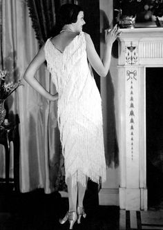 Photo of a chic Parisian wearing a Crepe-de-chine Vionnet with chevron patterning. 1925  Check out the Fire Place!!