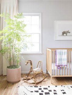 boho baby girl room with pink pot and rattan rocking horse