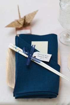 Origami place settings added such an incredible personal touch to Mallory and Danny's wedding day. Photo: Maison Meredith Photography