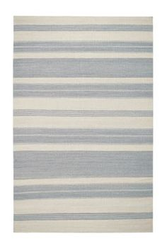 The Puhalo Stripe style is a new wool, transitional rug design from Genevieve Gorder and Capel Rugs. Puhalo Stripe rugs have a flat woven construction. The oslo gray colorway is a beautiful addition to our assortment of black and grey area rugs.