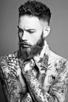 billy huxley, British model. He's only around 23-24; the beard gives him more visual maturity.