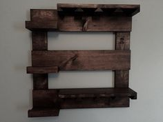 This beautiful wine rack is made from reclaimed pine that I have stained and distressed. It measures 24 x 24 with 3 shelves and wine glass holder. This rustic wine rack will look great in any room! Great gift idea