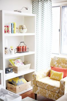 the chair and chevron curtains~ gray blue, mustard yellow and coral. {peaceful punch of color}
