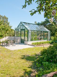 Nice two level foundation wall on this Custom Double Glass Cottage Orangery. http://garden-greenhouse.se/