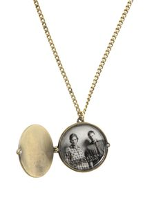 Gold tone necklace with a circular locket. Outside of locket has the anti-possession symbol and the inside has an image of Sam and Dean.