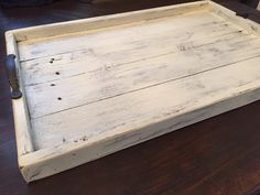 Here is our Shabby Chic wooden serving tray made out of reclaimed wood. Sanded for a smooth surface, but left all the qualities that make it rustic and beautiful! Old nails,holes, dings, and natural distressed spots make it what it is. We can custom build and finish to your