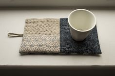 Hot pad made of Japanese fabrics, linen and hemp.  Handstitched by byknots.  So lovely.