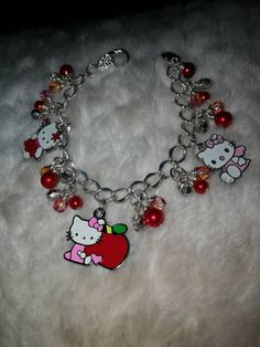 8c0a8aeea Hello Kitty Charm Bracelet by julesbeautifuljewels on Etsy Pearl Beads,  Lobster Clasp, Cute Cats