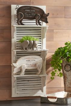 """""""Farmers Market' pig and a pig container brings the farm fresh look to the shutter shelf.  Farm Fresh Collection by RAZ Imports."""