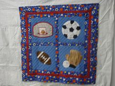 Appliqued sports themed baby quilt by Linda Souchik