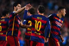Lionel Messi of FC Barcelona celebrates with his teammates Neymar (L) and Luis Suarez of FC Barcelona after scoring the opening goal during the La Liga match between FC Barcelona and Celta Vigo at Camp Nou on February 14, 2016 in Barcelona