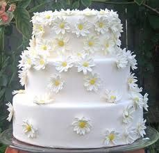 White with white daisies and pale yellow centers