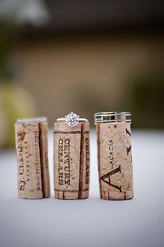 Great idea for a wedding ring shot! - use from our 1st bottle of wine shared together!