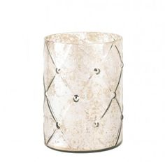 Make a style statement in your home with this large mercury glass candle holder. The quilted pattern and silvery shimmer will dance with glamorous glow when you light the candle of your choice inside!  Mercury glass. Candle not included.