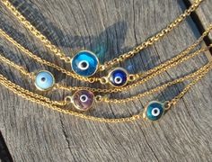 Gold Chain Evil Eye Bead Bracelet by cocolocca on Etsy, $6.50