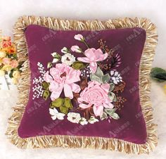 Pink roses on Burgandy velvet pillow...