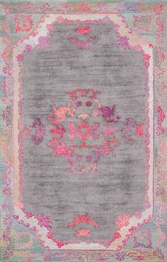 So whimsical and calming. This is Rugs USA's Bavoda BD02 Hand Tufted Sunny Medallion Floral Border Rug!