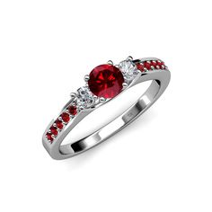 If your love glows timeless for her, let her know it with this 1.05 ct tw Three Stone Engagement Ring which Centers Ruby flanked with two Diamond along with small side Ruby to treasure the most beautiful moments of life.