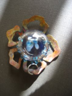 copper daisy pendant with a glasstop