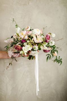Whimsical Peach and Purple Bouquet with Botanical Flowers