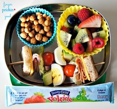 Here's what's inside: Sandwich Skewers (1/2 slice bread, 1/2 slice American cheese, 2 slices of ham, lettuce, 2 grape tomatoes, 1/2 hard-boiled egg, 2 avocado chunks, threaded onto 2 popsicle sticks)= 7 carbs The Good Bean Sweet Cinnamon Chickpeas= 18 carbs Stonyfield YoKids Yogurt Tube= 11 carbs Strawberries= 3 carbs Blueberries= 3 carbs Raspberries= 1 carb Kiwi= 4 carbs Lunch Total= 47 carbohydrates