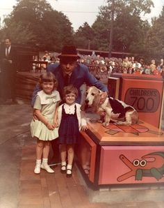 """Stan Boreson, legendary Seattle entertainer and the """"King of Scandinavian Humor"""" with his dog No-Mo and two unidentified kids, opening day of the Woodland Park Children's Zoo, June Female Gorilla, Western Lowland Gorilla, Western Washington, Washington State, Woodland Park Zoo, Reptile House, Ostriches, Pony Rides, Pet Cage"""