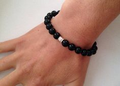 Black agate bracelet with Sterling silver focal bead and fancy toggle clasp. This elegant bracelet features 8mm smooth and shiny black agate beads with a