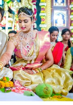 South Indian bride. Diamond Indian bridal jewelry. Jhumkis.Gold silk kanchipuram sari.Braid with fresh jasmine flowers. Tamil bride. Telugu bride. Kannada bride. Hindu bride. Malayalee bride.Kerala bride.South Indian wedding