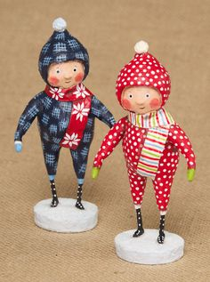 "- Resin & wire. - 6"" tall. - Set of two assorted children in snowsuits. - A Lori Mitchell design. - Photo Courtesy of ESC & Company. - Imported."