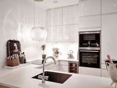 white modern kitchen, ideas Scandinavian crib Delightful Scandinavian Apartment Quenching a Thirst for Neatness