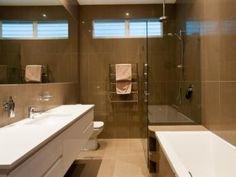 Modern bathroom design with recessed bath using frameless glass - Bathroom Photo 1330756
