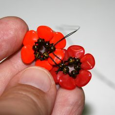 Pretty - a little complicated, but very pretty and could be used as components instead of a full bracelet. Flanders Poppy from Preciosa