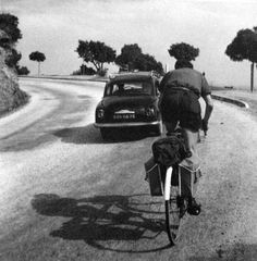 Robert Doisneau // Cycling, 1959 - Route Nationale 98, France.