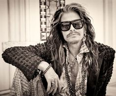 Steven Tyler/Steven Tyler is very photogenic.You can't help ,but pin him because,he takes such good pictures.