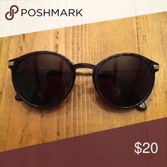 Vintage sunglasses with gold metal temples. Vintage.  Dark blue frames with dark brown lenses.  Gold end pieces and temples.  In great condition and versatile! Open to offers! Accessories Sunglasses
