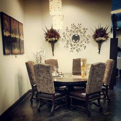 Rio Grande Dining Table and Chairs from Home Trends. Real mango wood, hand carved base, and iron work.