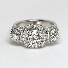 Cushion cut Diamond Three Stone Ring from Oliver Smith Jeweler.