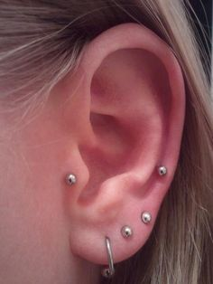 Left ear piercings: tragus & outer conch cartilage, 3 lobe.