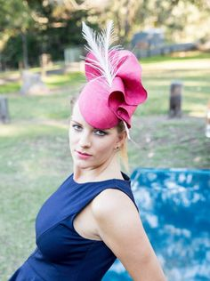 A beautiful pink straw teardrop fascinator with 2 white feather quills.