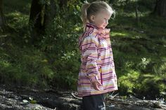 Little girl playing outside in Helly Hansen jacket.  Photo by Berit Bergestig