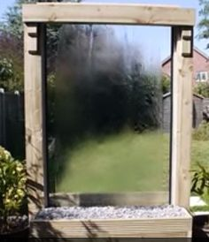 DIY Water Wall | Tips & Instructions To Build A DIY Water Wall | Add some intrigue to your backyard landscape with a water wall that recycles the water.