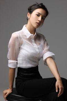 Transparent blouse over chemise.