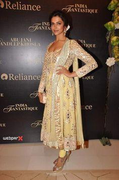 Deepika Padukone wearing a light yellow churidhar.