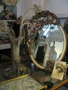Pretty vintage/antique display with barbola mirror and Venetian glass (Jeannie Geiken, Beautiful Barbola).