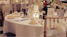 Tables at the Jaguar wedding - ivory linens, chiavari chairs with ivory organza sash, DIY menu frames, luminary table numbers & bouquet centrepieces. #Sydney