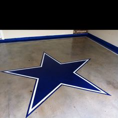 My new stained garage floor! Took me 2 days.. Go Cowboys!